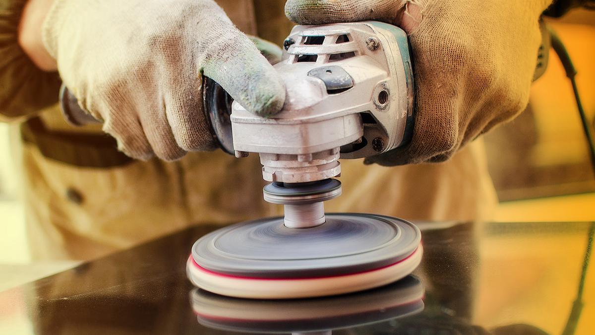 Worker Polishing Stone