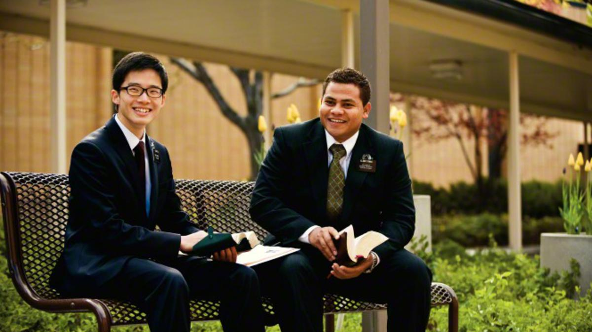 Two elder missionaries sitting on a bench at the Missionary Training Center.