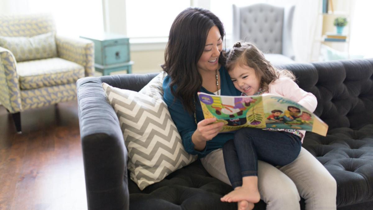 a mother and a daughter reading a magazine