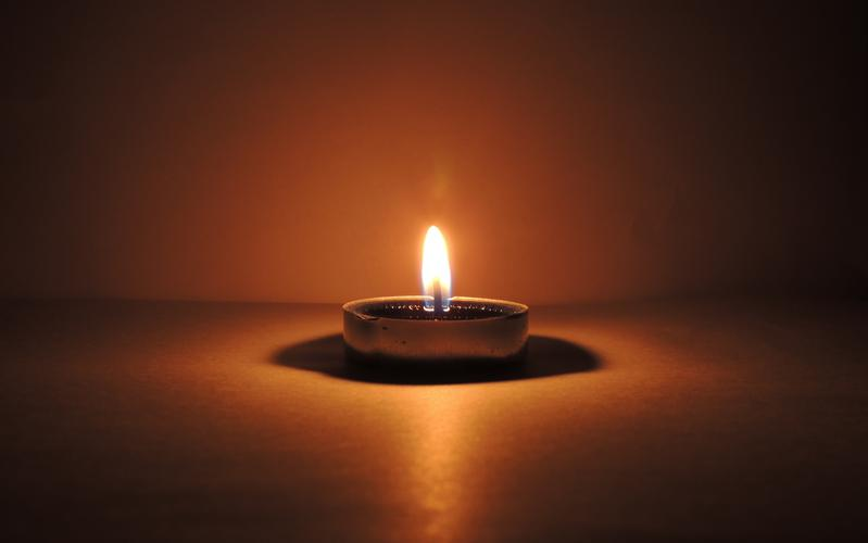 One candle can make a difference. A lone candle lights up a dark space.