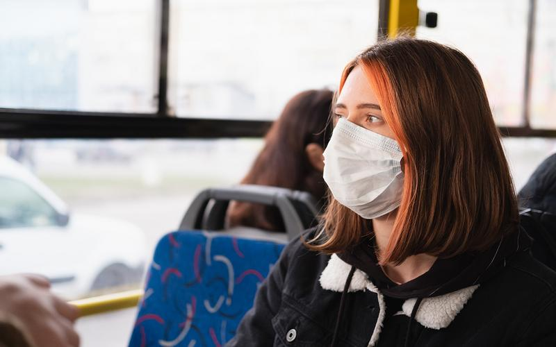 Girl on bus with mask
