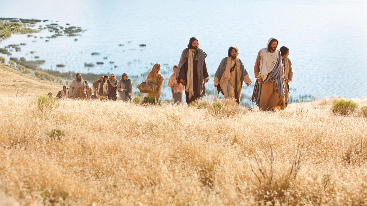 Jesus Christ walking with His disciples.
