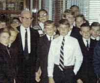 Elder Evan A. Schmutz with a quorum of teachers and deacons meeting Elder Joseph Fielding Smith