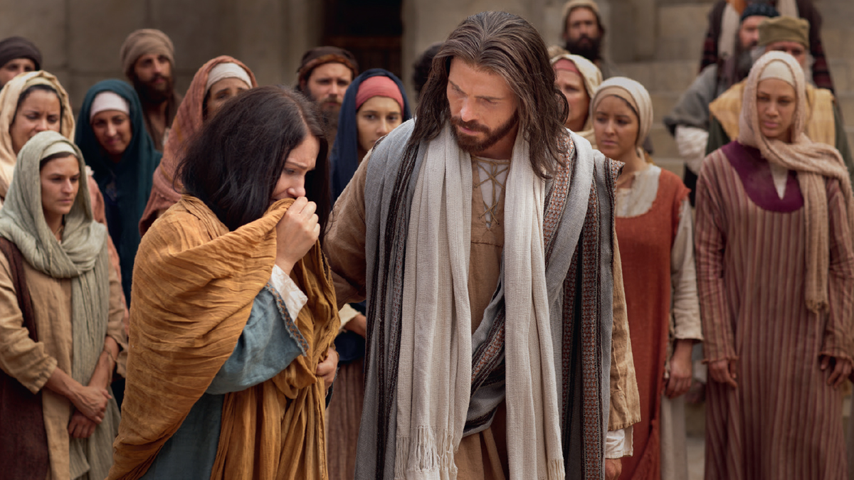 Jesus Christ ministering to the woman taken in adultery.