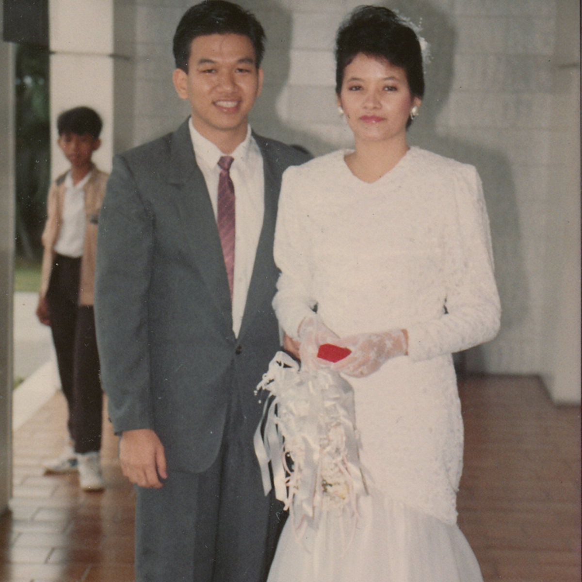 Elder and Sister Teh getting married in the temple