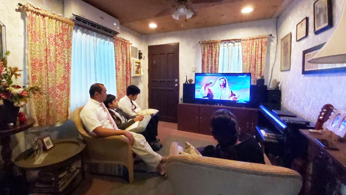 A Filipino family watching General Conference on a local TV channel.