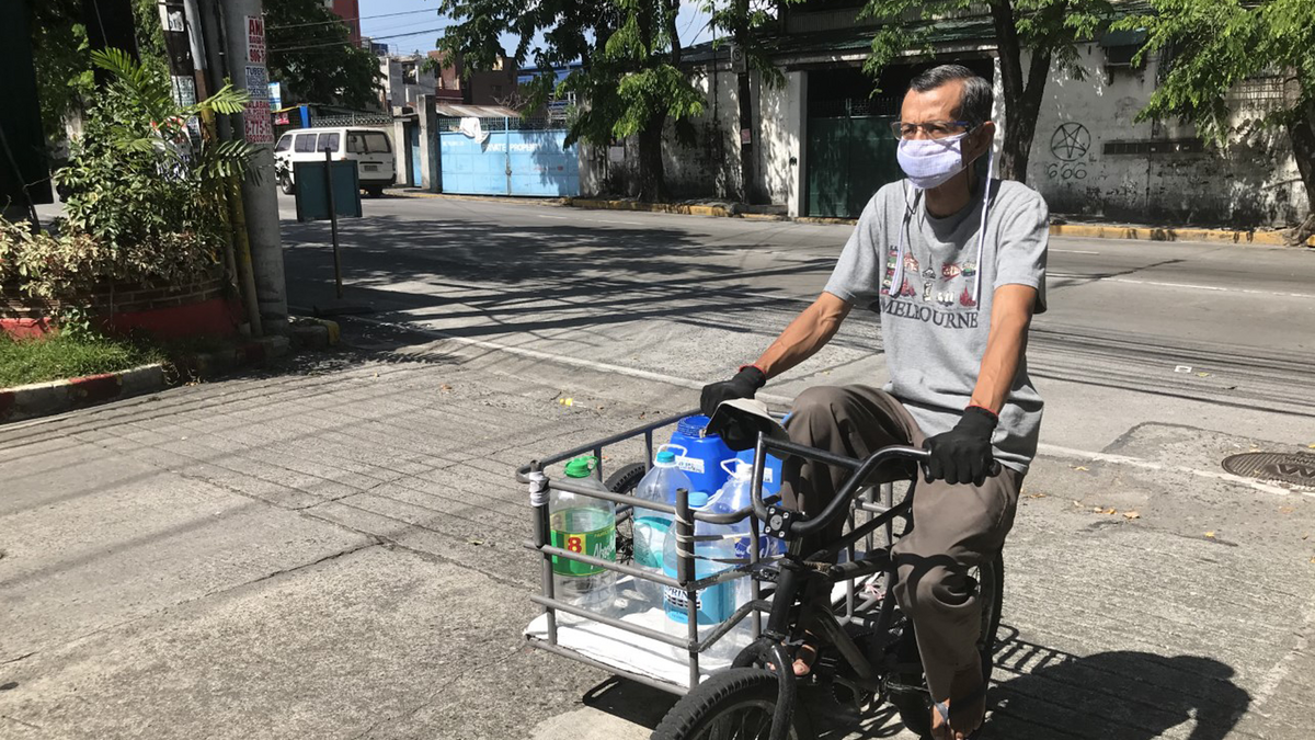 Samuel Mabunga delivering water