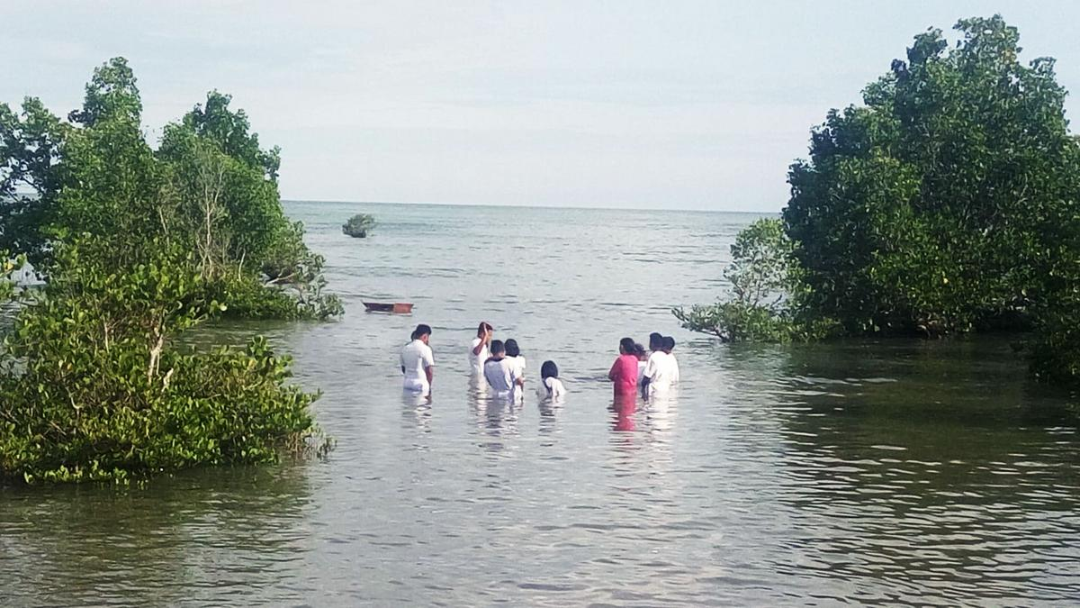 Baptism by a river in Curuan