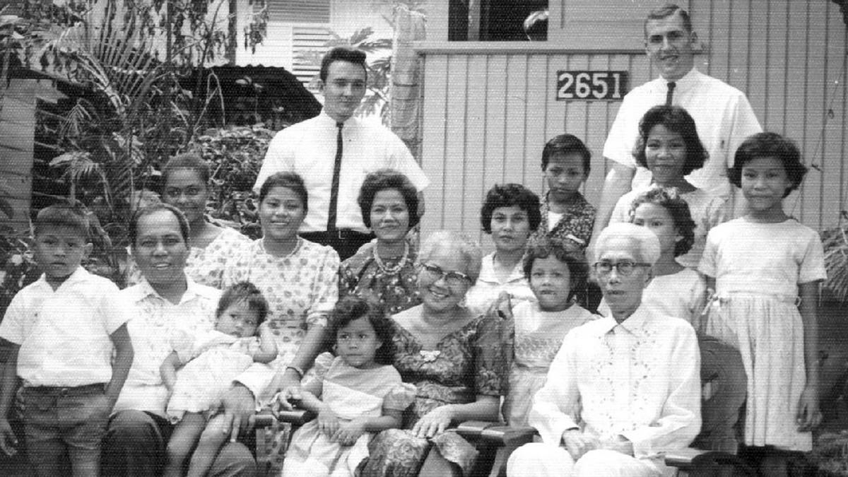 Elder Kent Lowe and his companion are shown with members of the Andrada family in 1961, the year The Church of Jesus Christ of Latter-day Saints was officially established in the country.
