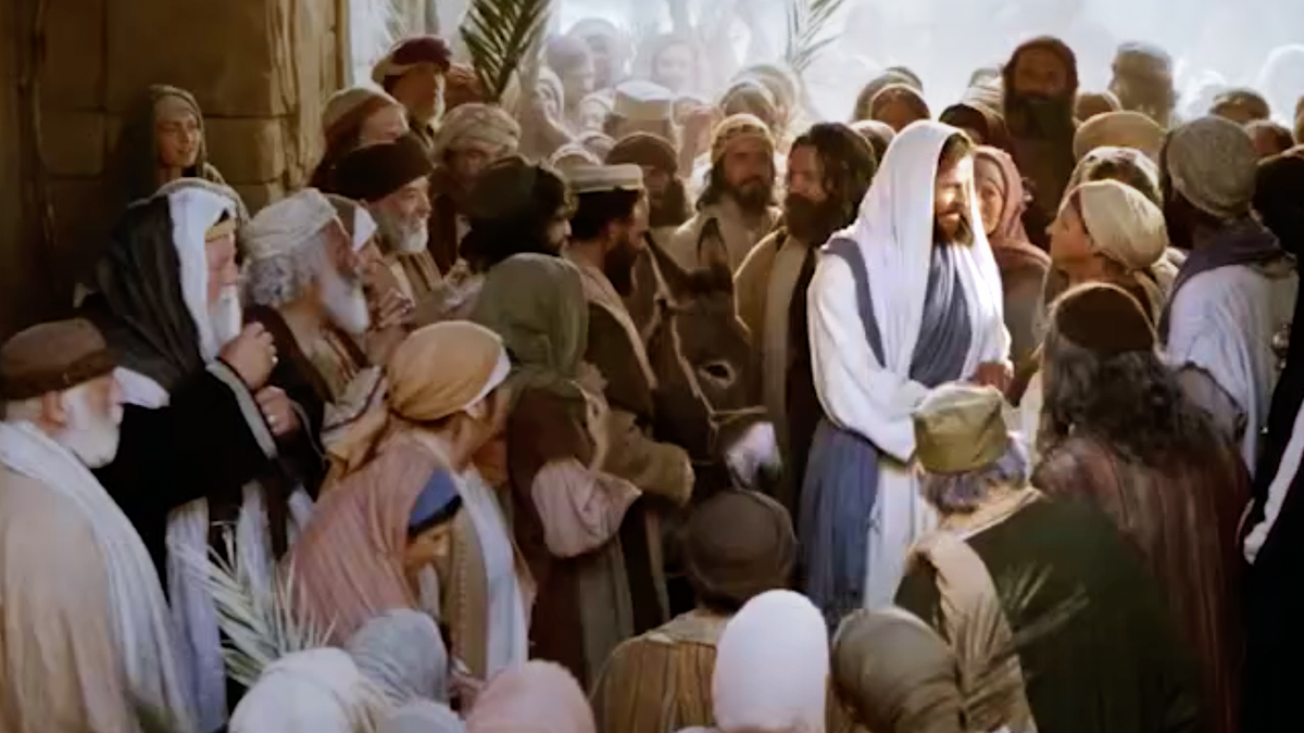 Jesus Christ in the middle of a crowd.
