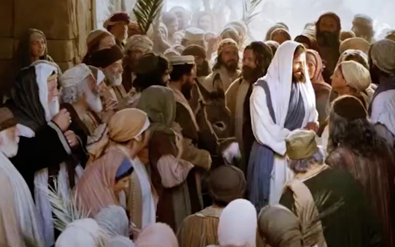 Jesus greeting a crowd of people.