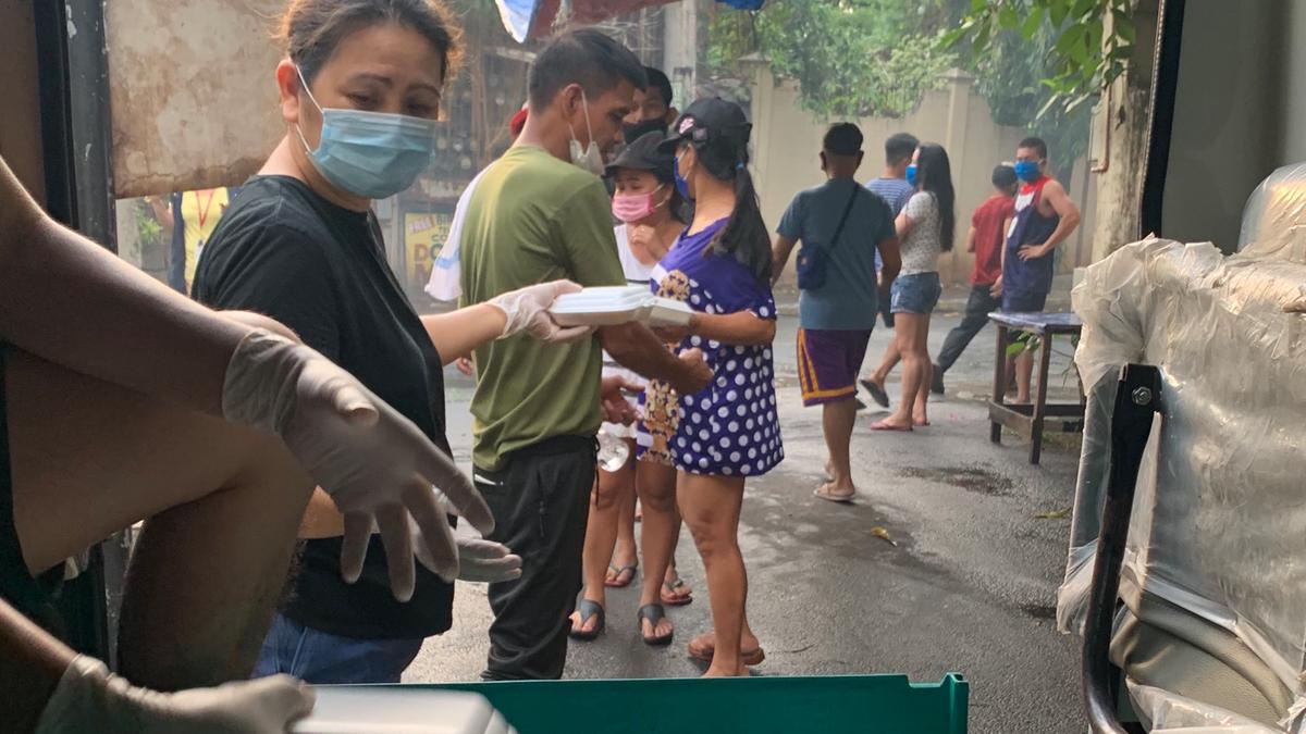 Ma. Imelda T. Maroket distributing food packs