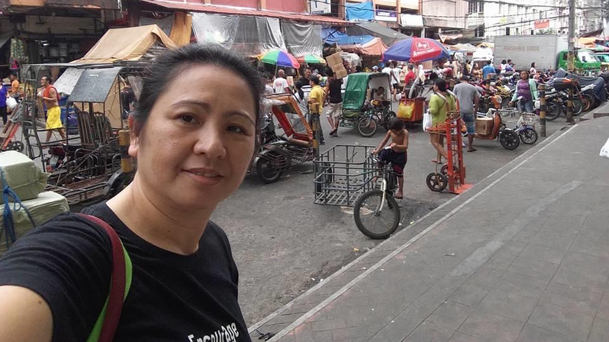 At the market to buy what is needed for her next event.