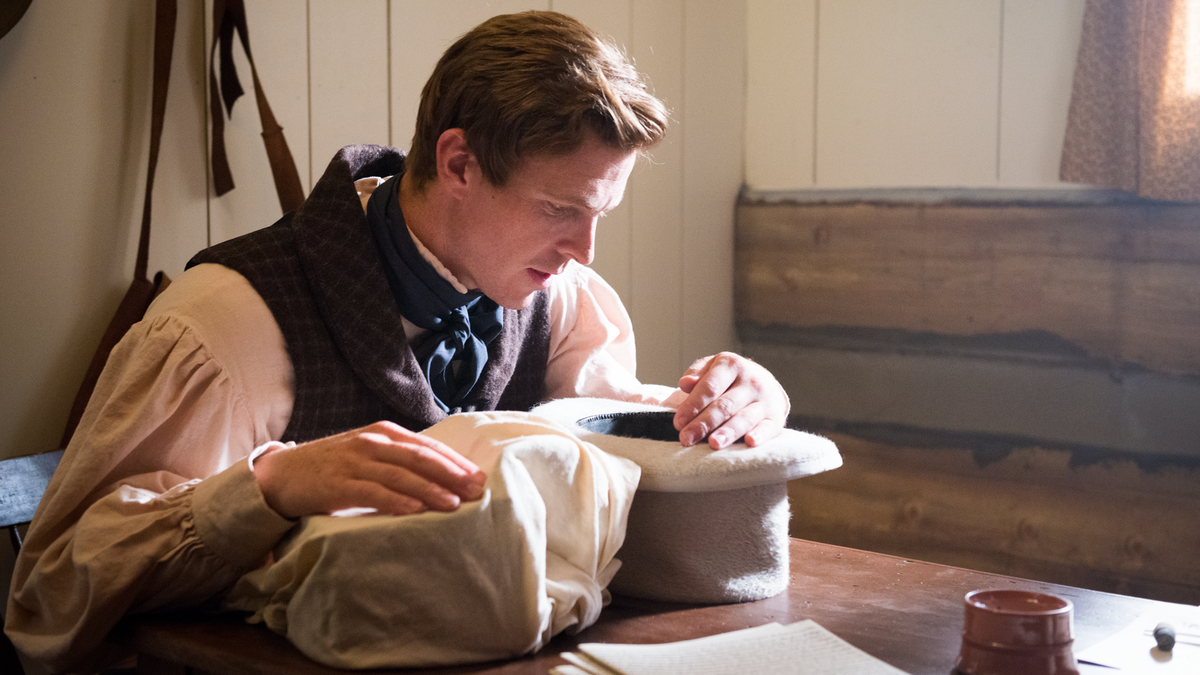 Joseph Smith using the seer stone to translate.