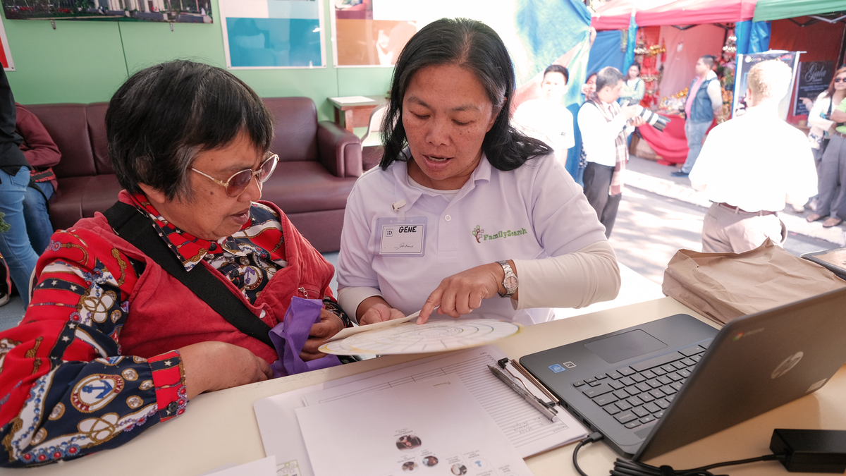Volunteers help others with their family history.