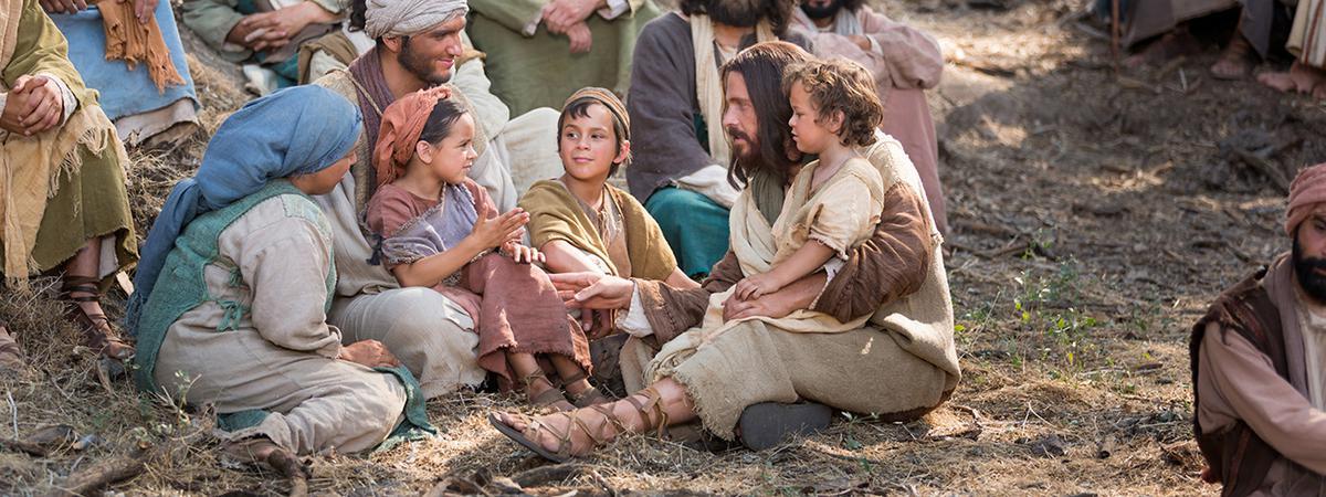 Jesucristo enseñando a una familia joven.