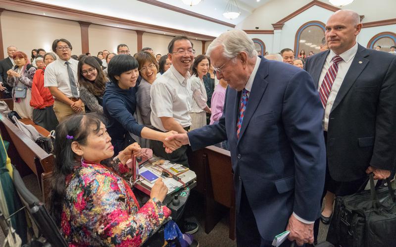 M. Russell Ballard greets congregation