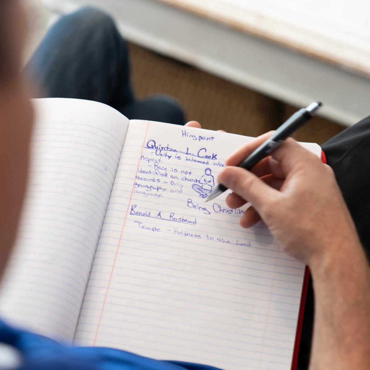 A Latter-day Saint in Idaho takes notes of what is being said during general conference on Saturday, October 3, 2020.