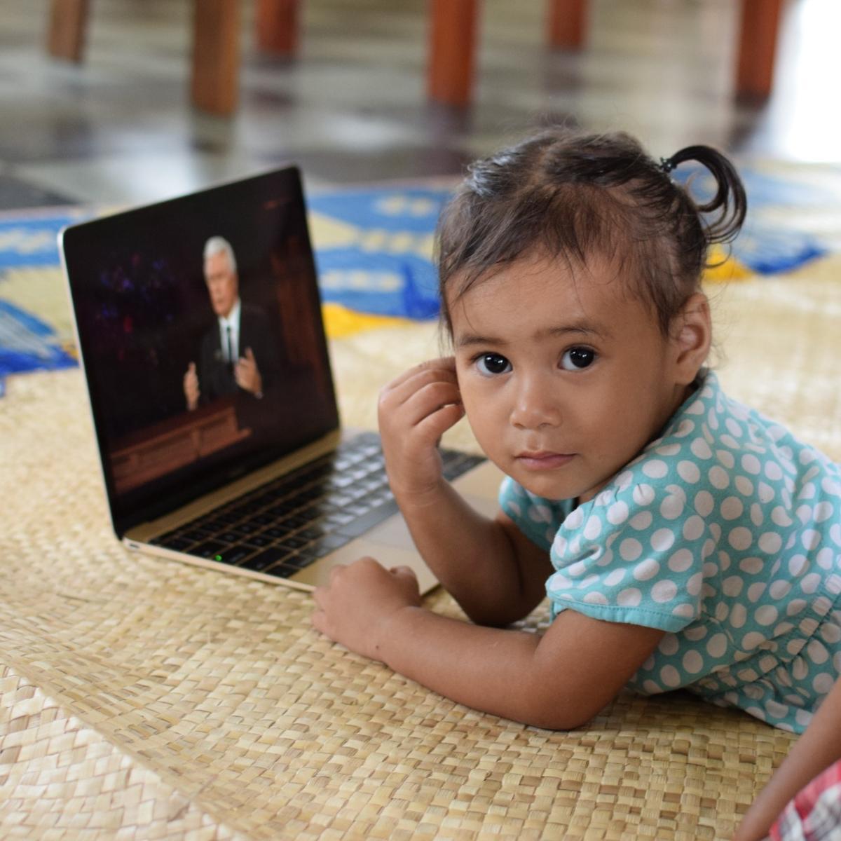 Children in Samoa listen to Elder Dieter F. Uchtdorf of the Quorum of the Twelve speak at general conference on Saturday, October 3, 2020.