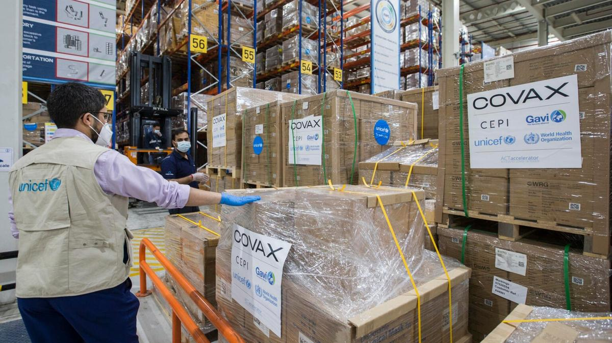 UNICEF staffer Rafik ElOuerchefani inspects pallets of auto-disable syringes and safety boxes at a warehouse in Dubai Logistics City in the United Arab Emirates on February 21, 2021.