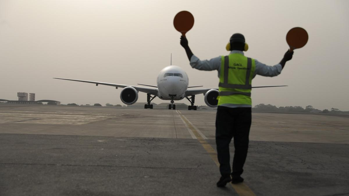 A plane carrying the first shipment of COVID-19 vaccines distributed by the COVAX Facility lands at Kotoka International Airport in Accra, Ghana, on February 24, 2021.