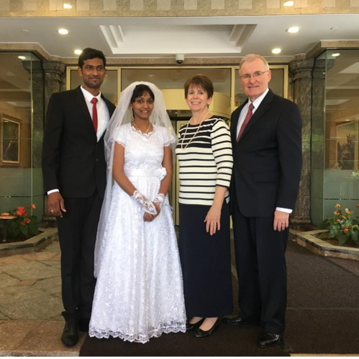 Elder and Sister Funk enjoy being with members who come to the Hong Kong Temple to be sealed.