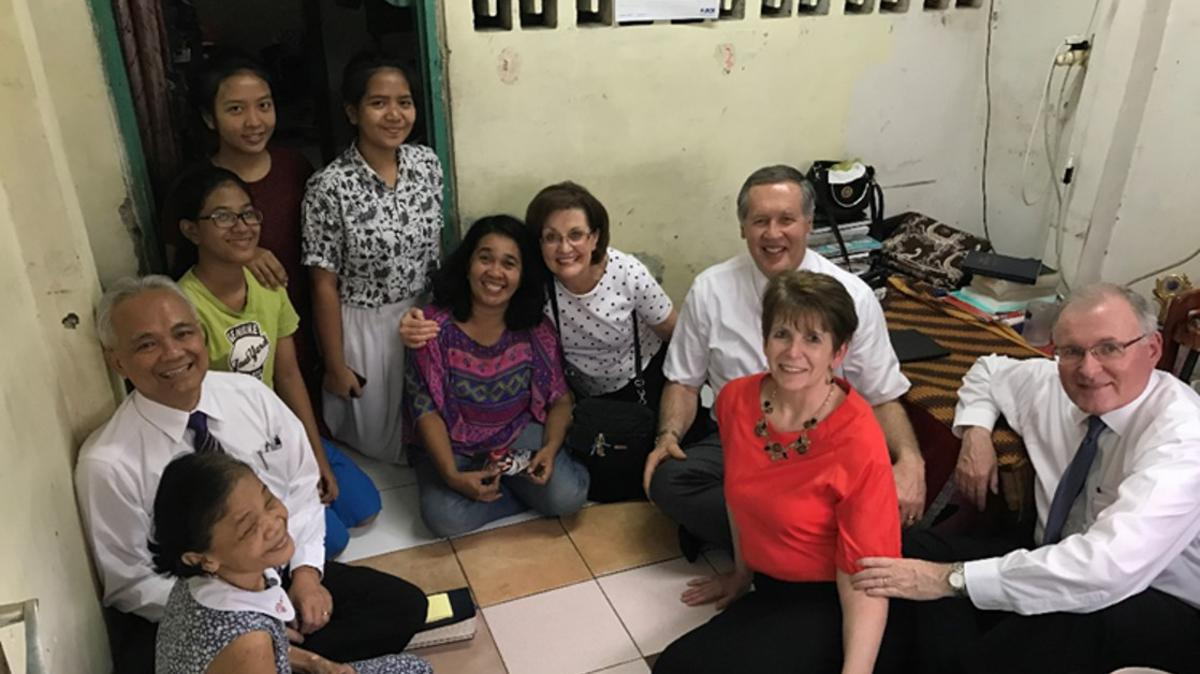 Elder and Sister Funk with then stake president Djarot Subiantoro (now an Area Seventy) visiting a family in Jakarta, Indonesia.