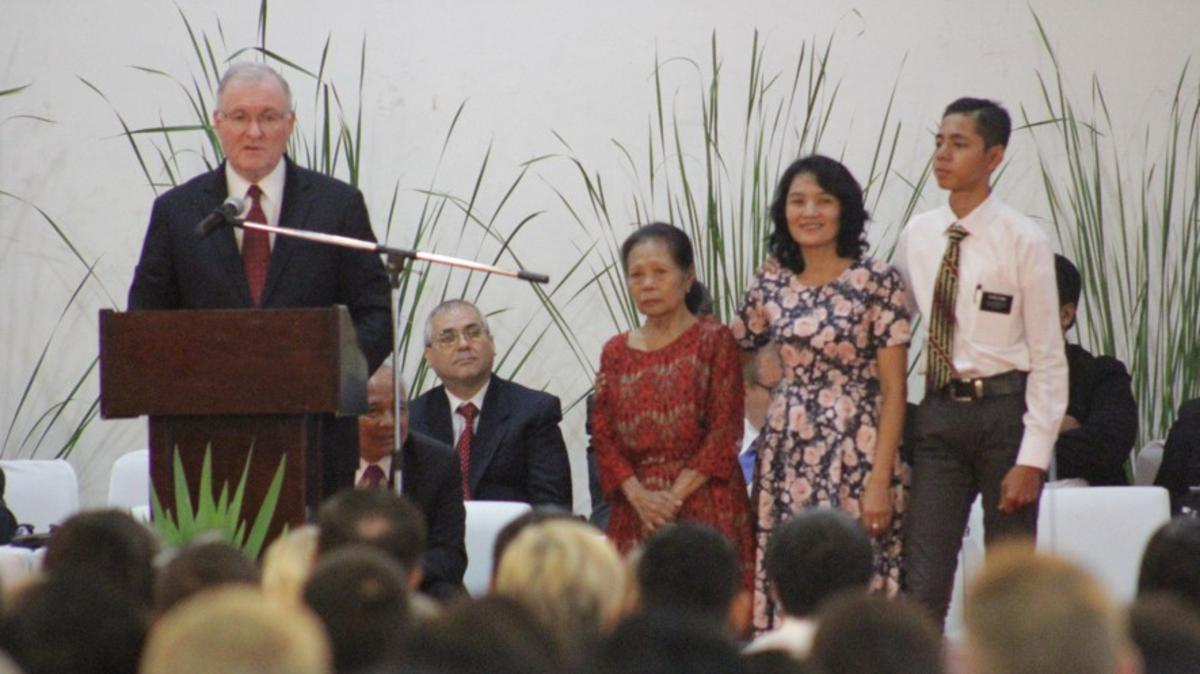 Elder Funk with three generations of a four-generation member family in Indonesia.