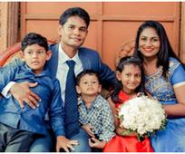 Image of a Anthony Roshan and his family