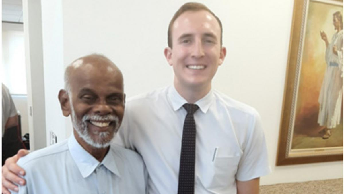 image of missionary and member