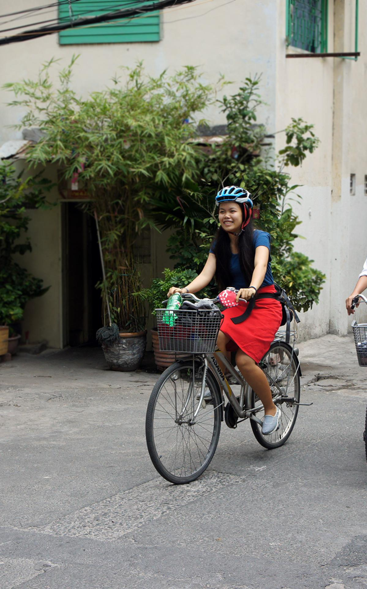 2-sisters-riding-bicycle-in-an-alley-way-hem-2015-05-2.jpg