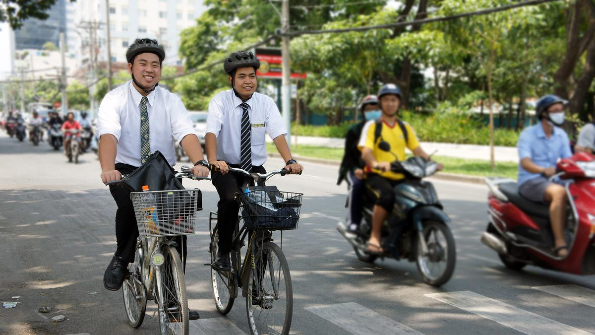 2-elders-in-white-shirts-and-tie-riding-bicycle-2015-05.jpg