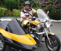 1 Banner Colin on Motercycle.jpg
