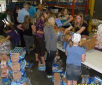 Regina Fires Support.BANNER.volunteer packing line.jpg