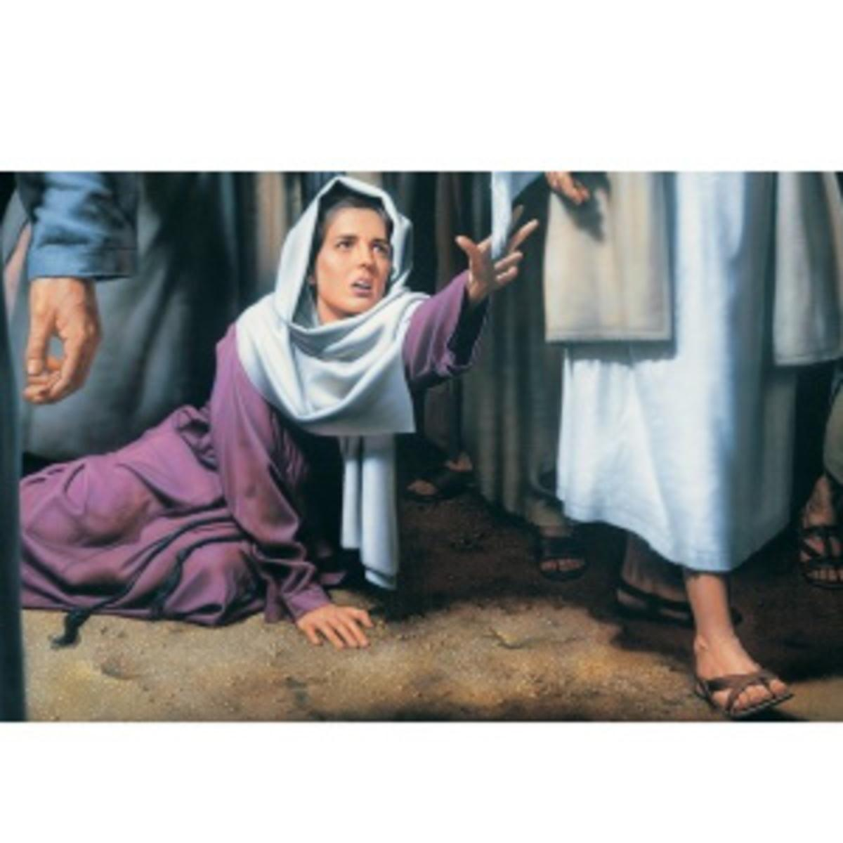 woman reaches for cloak