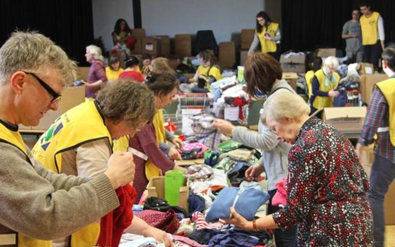 sorting goods for refugees