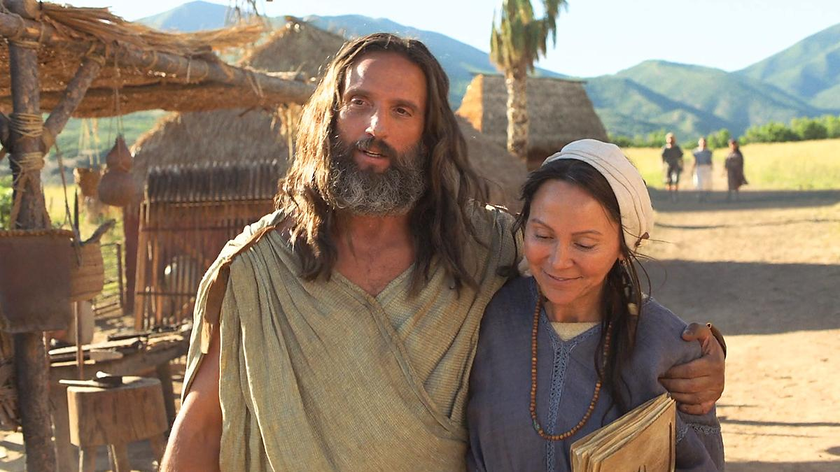 Nephi walking happily with his wife.