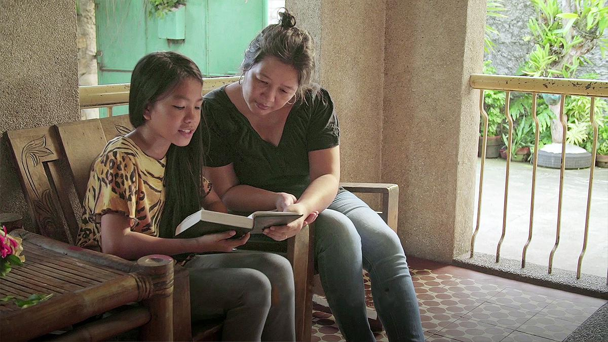 Mother and daughter reading the scriptures