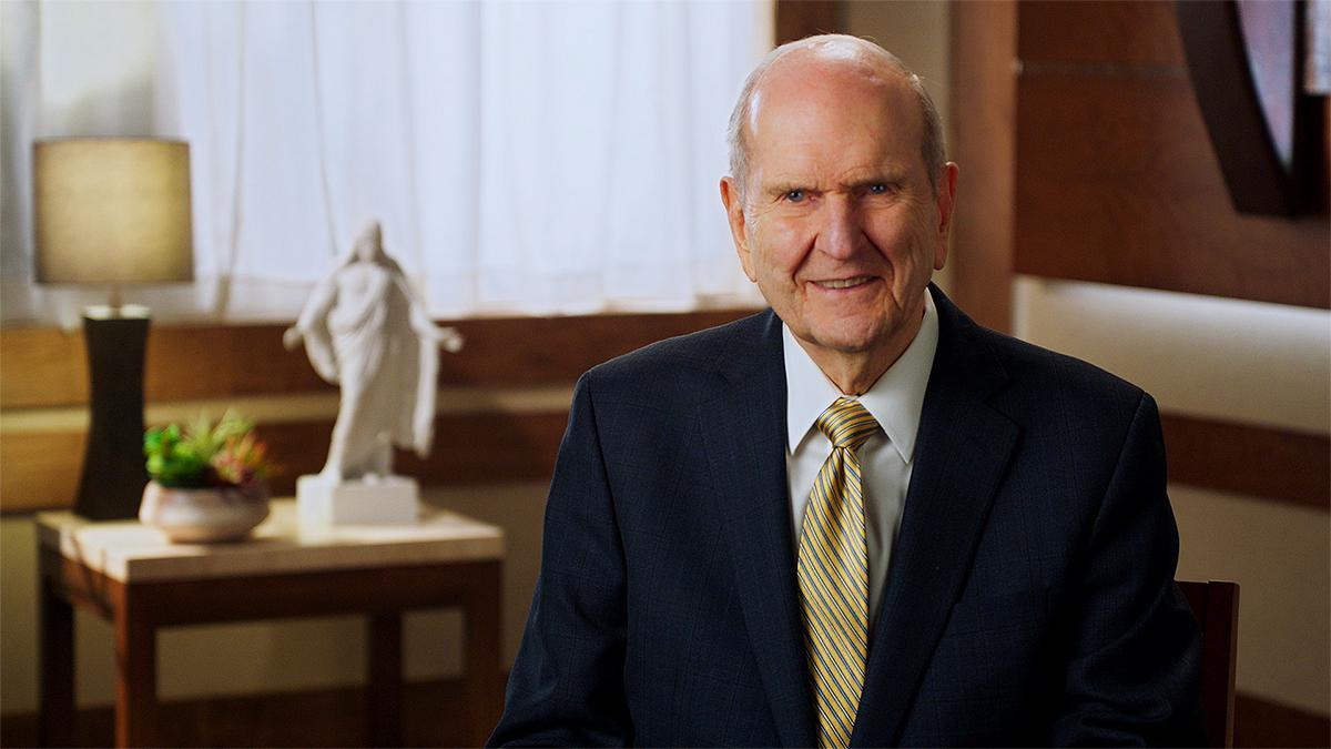 President Nelson sat smiling at the camera