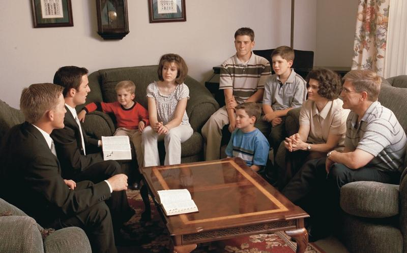 Missionaries teaching a family