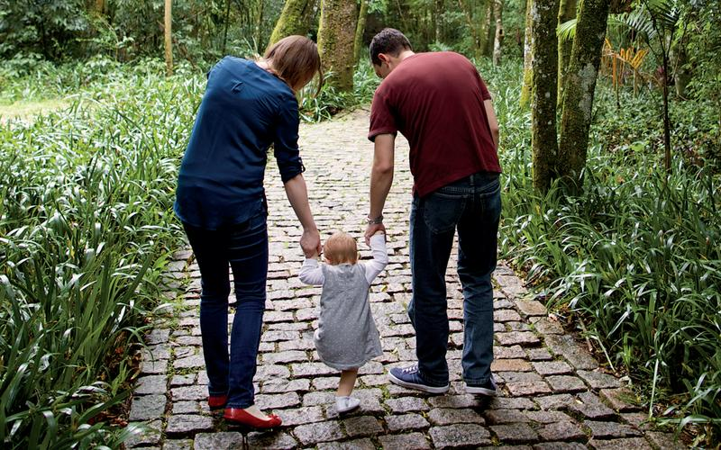 A family walking down a path