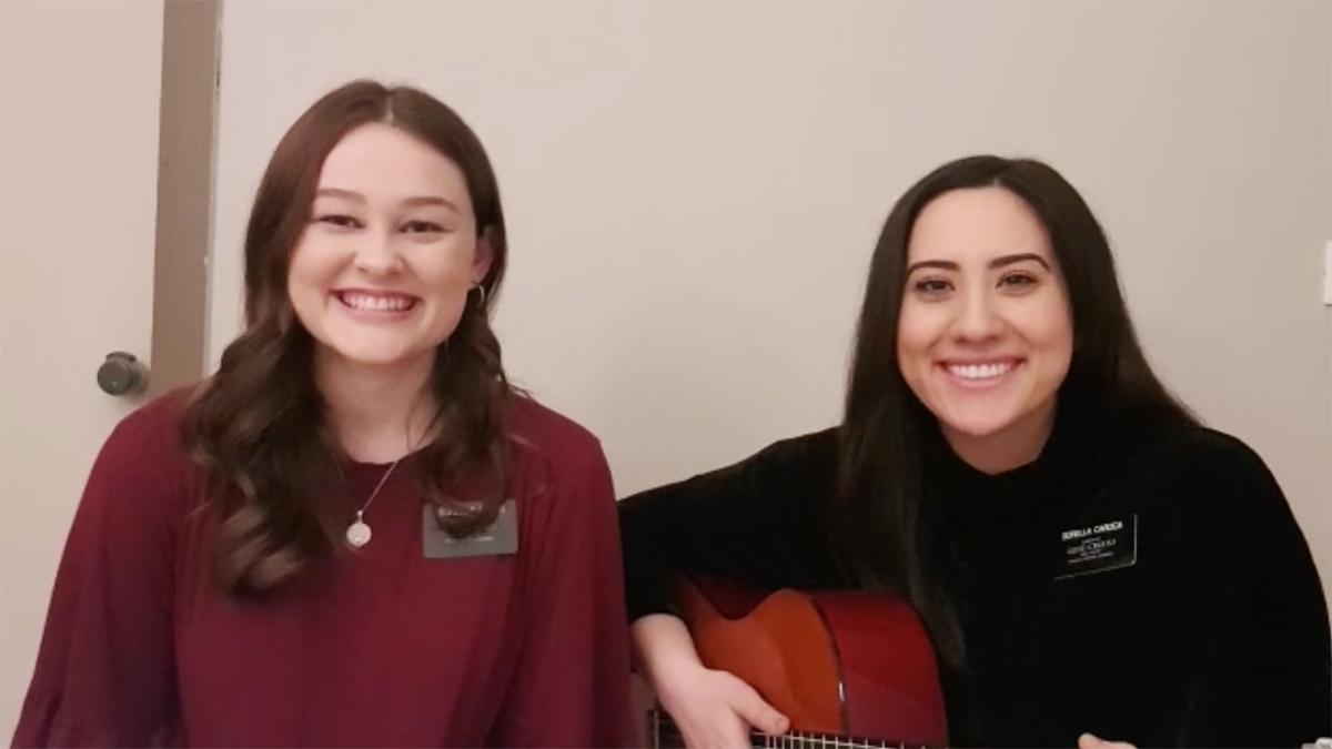 two sister missionaries with guitar