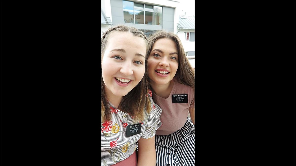 two smiling sister missionaries