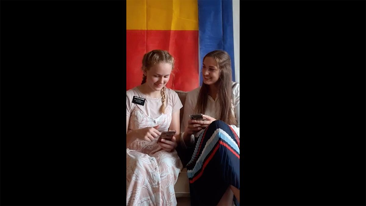 two young women with their smartphones