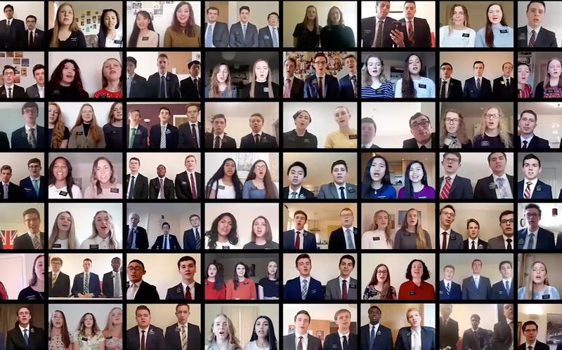 a screen of an online conference with missionaries singing