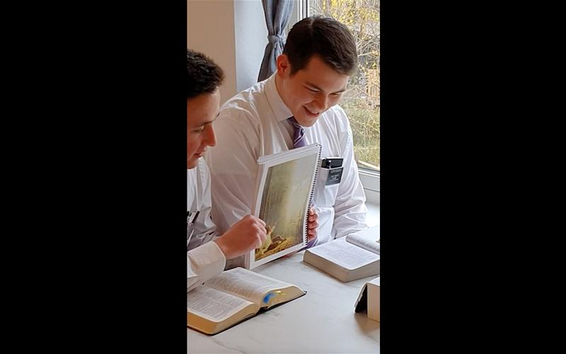 two missionaries teach using their smartphone