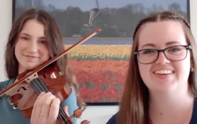 Sister Missionaries singing and playing the violin