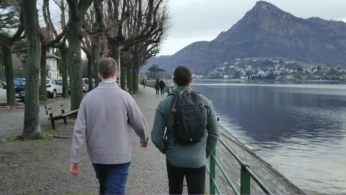 Two Elders walking in a natural setting.