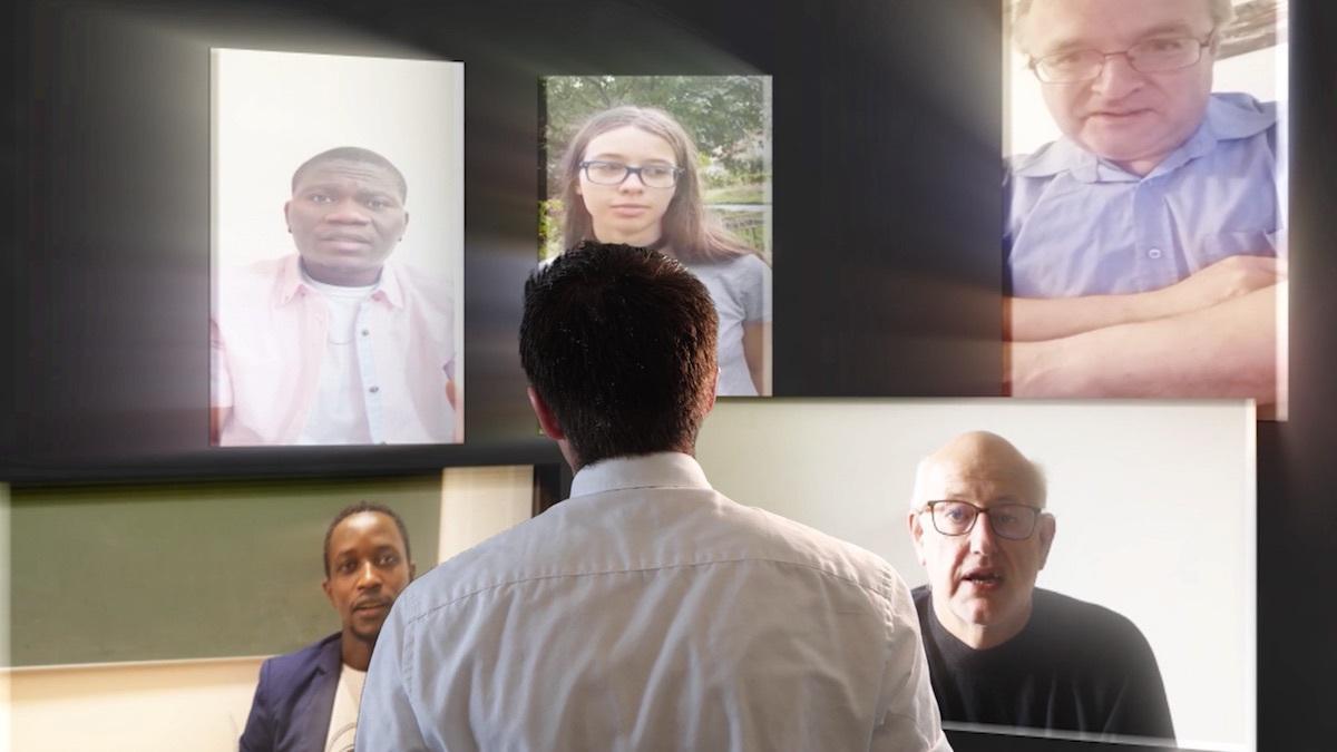 A missionary looking at virtual screens