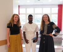 Sister Missionaries and a man being baptized